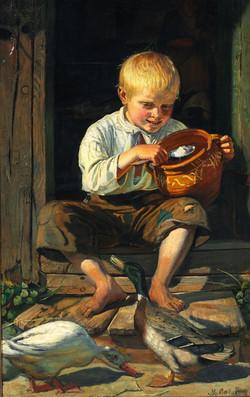 Dreng fodrer ænder A boy feeding the