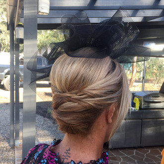 Hairstyle with a fascinator.jpg
