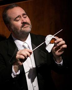 Monty Carter, conductor, violin and viola, funnyman,