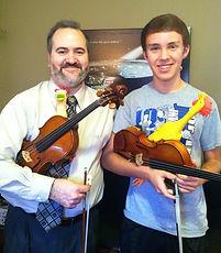 Monty Carter, violin, viola, instruction, rubber chicken, mascot
