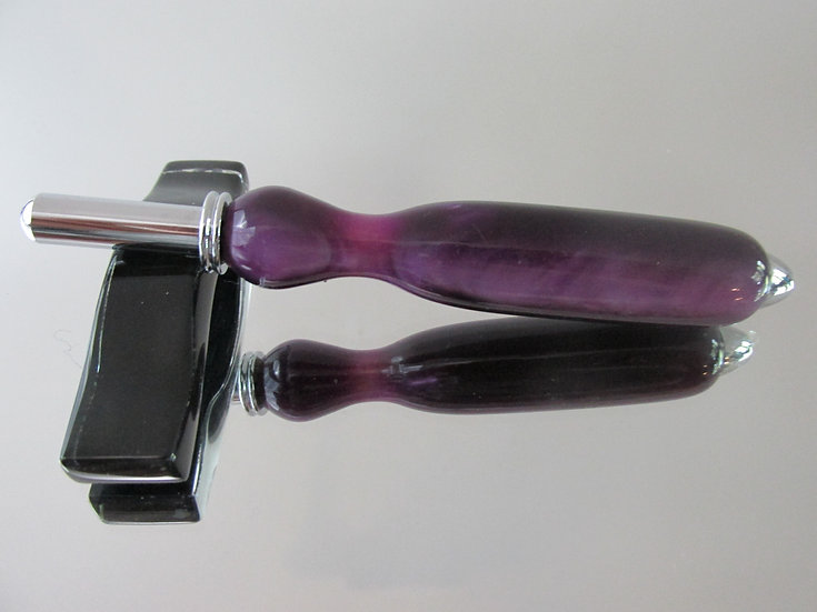 The seam ripper/sewing stiletto is handmade from Lavendar Acrylic Acetate