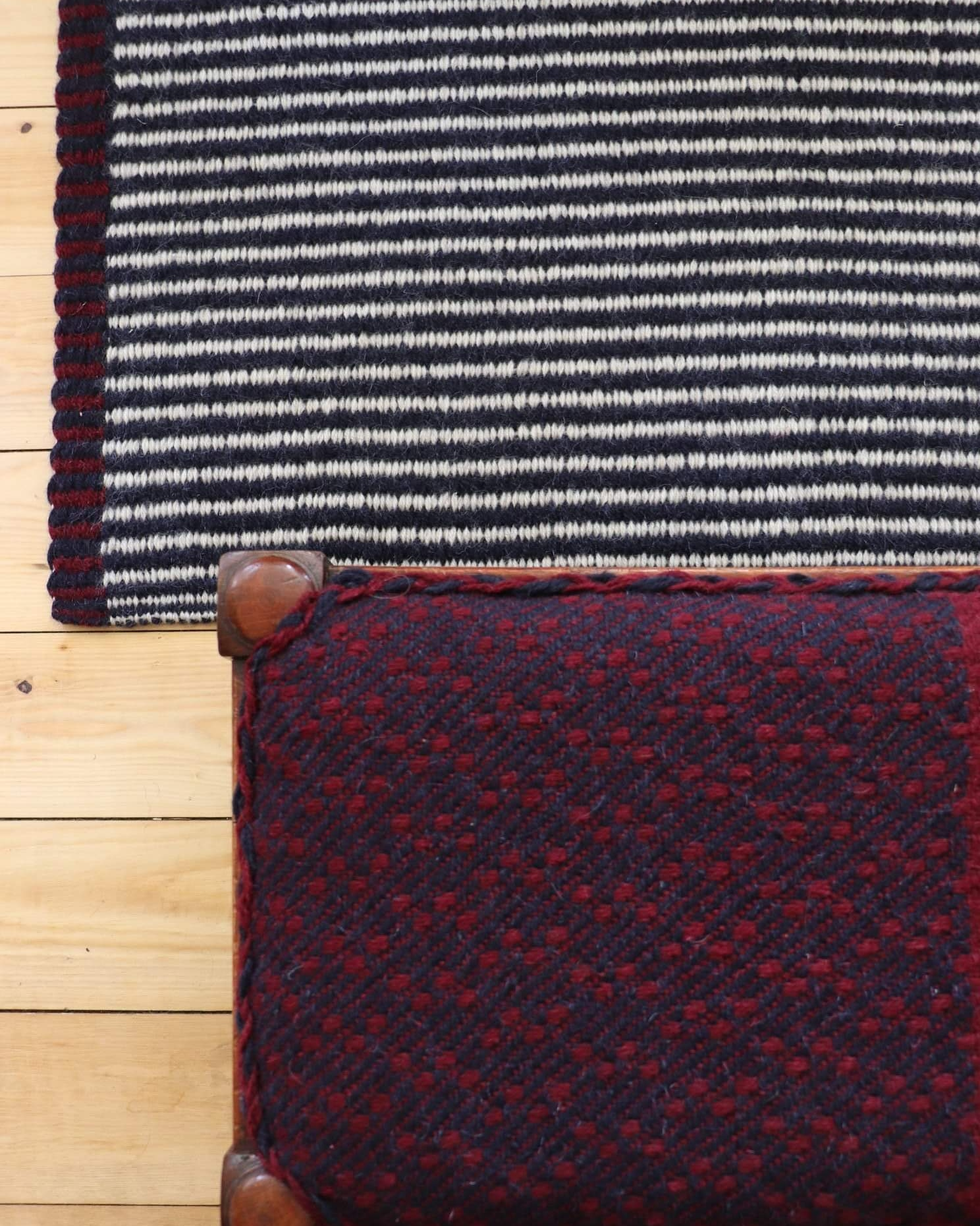 Handwoven rug and upholstered stool