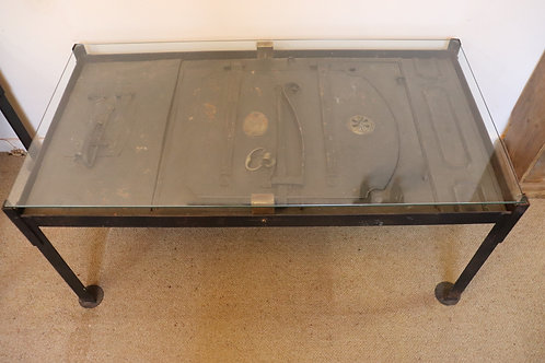 Metal Oven Door, set in cast iron legs with a thick glass top.