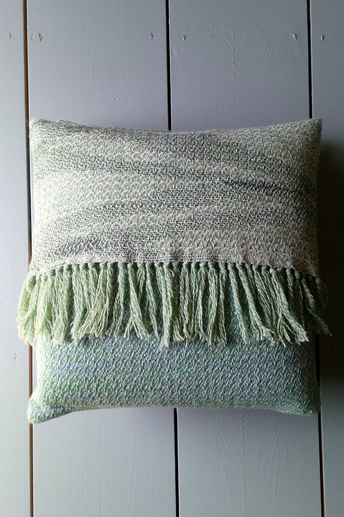 Tasseled cushion