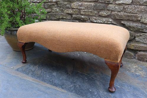 Reupholstered footstool