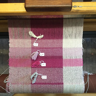 handwoven fabric on a weaving loom