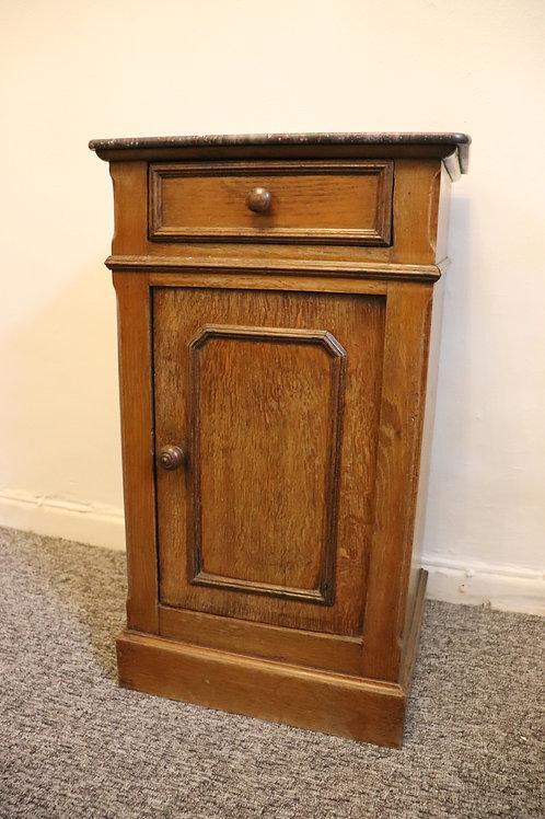 Oak marbled top bedside cupboard