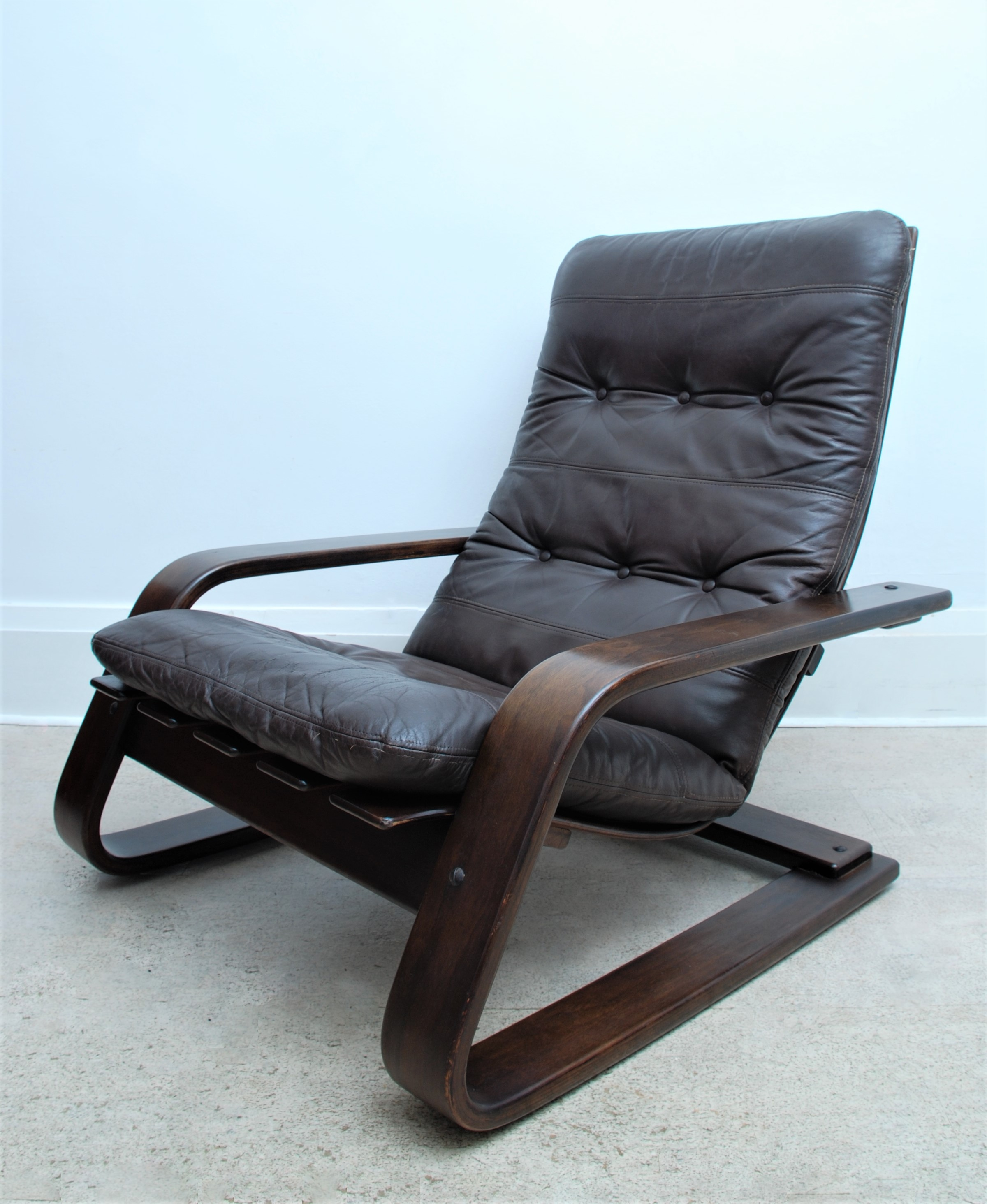 LEATHER CANTILEVER ARMCHAIR (2)