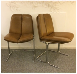 PIEFF CROME AND LEATHER CHAIRS