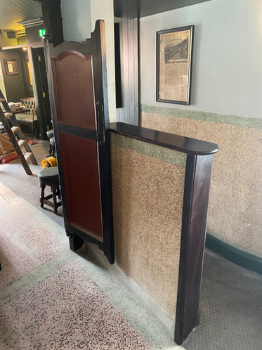 Original batt swing doors and mosaic wall panelling retained