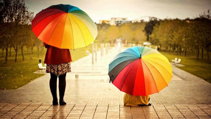 two girls with umbrellas