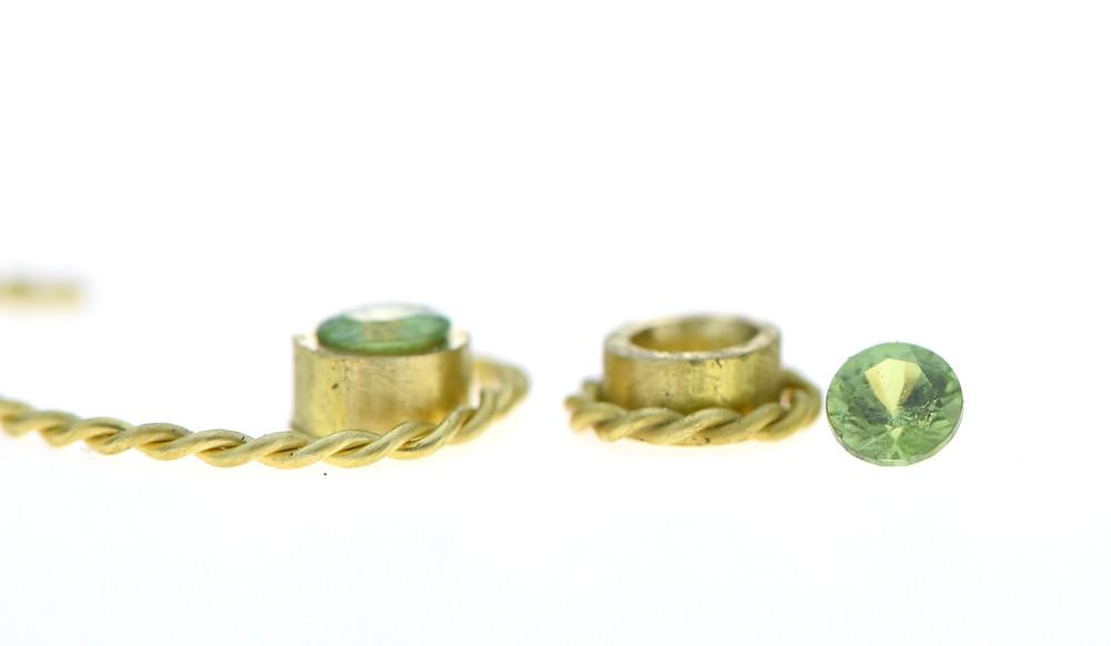 18k gold earrings with green garnets