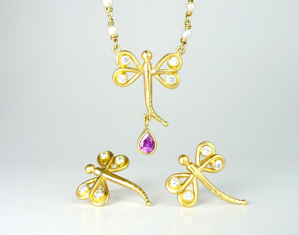 dragonfly earrings and necklace handmade in 18k gold with a purple sapphire and diamonds