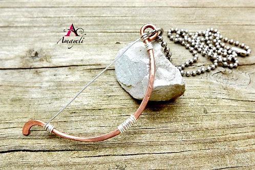 Primitive bow necklace