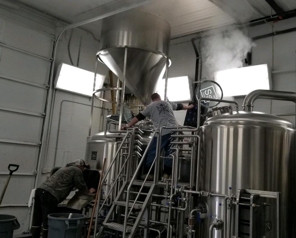 Brewmaster Nick and Tim brewing2.jpg