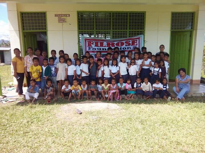 Students in front of a FilRose Peralta Foundation funded elementary school.