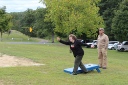 Margaret at the corn hole throw