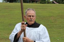 Bob C carrying cross Mass OLG Picnic