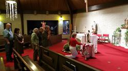 Parishioner's Venerating   Relic