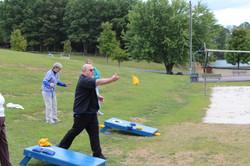 Fr Bill  at the corn hole throw