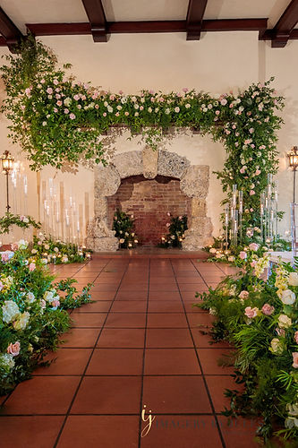 Fireplace Wedding flowers greenery candles hanging arrangement ceremony site Miami Florida Georgia Wedding Aisle florals