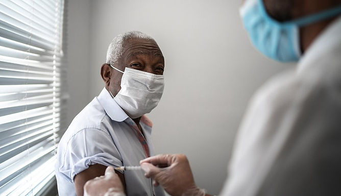 black getting vaccine.jpg