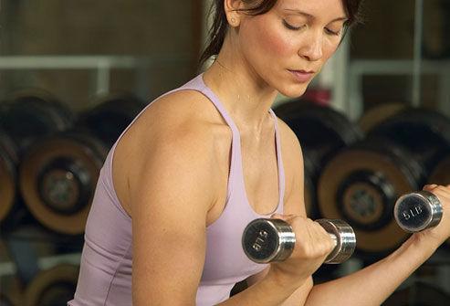photolibrary_rf_photo_of_woman_lifting_w