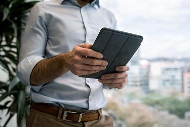 young man professional ipad tablet.jpg