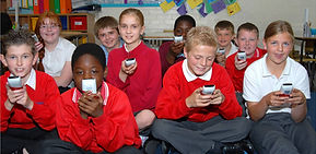 Kids using Qwizdom (from poster).jpg