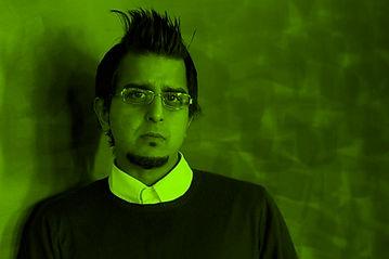 Madani Younis green.jpg