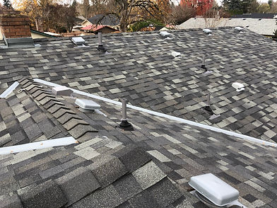 A Salem Oregon Roof receiving annual maintenance by Marcano Roofing Contractor