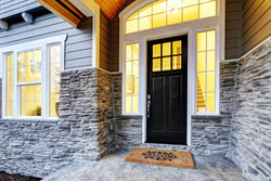 Revive Exteriors stone installation on house