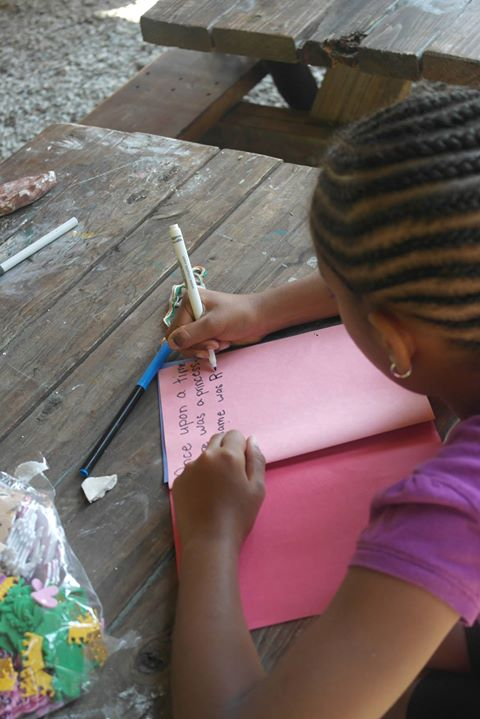 Najah  is writing a book.