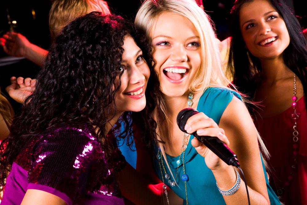women singing karoke