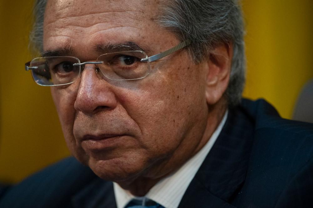 Paulo Guedes seguiu a cartilha neoliberal e não recuperou a economia. (Foto: Mauro Pimentel/AFP)