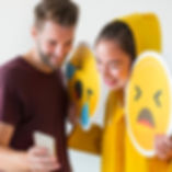 couple-taking-selfie-with-emojis-P3GQHL9