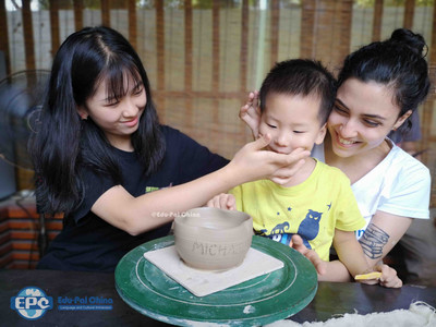 Cultural Care Au Pair in China :Pottery Activity with family