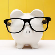bigstock-Piggy-Bank-With-Glasses-Over-Y-