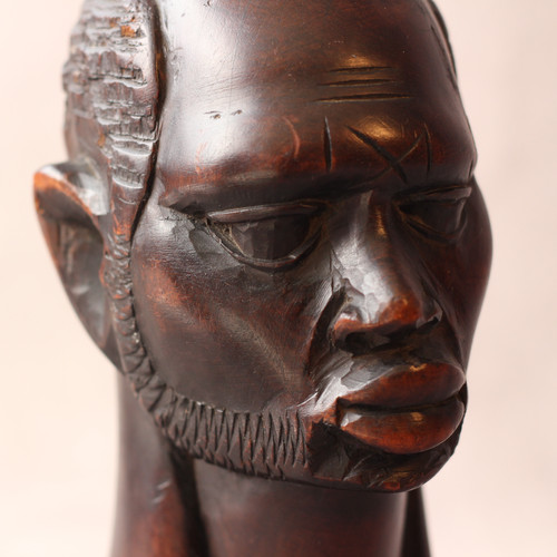 """Bust of African Man We all loved this powerful sculpture the first time we saw it, and obtained it in an exchange with another collector of African Art. Though only 9"""" tall,  it is expressive,  and conveys the angst of the times effortlessly. A beautiful face carved in Africa, through its unspoken empathy, radiates a certain soothing and healing effect. Restored in house by M. Lurie. Dimensions (inches): H 8.5"""" W 4"""" D 4.5""""  $125"""