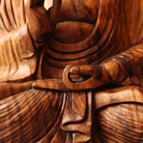 """Indonesian Buddha Carving This serene Indonesian Buddah, with the hint of a peaceful smile, is artfully carved out of a solid piece of tropical hardwood,  most likely Teak. This is a precious piece from Mark's personal collection as it reminds him of his time in Indonesia studying under a master carver in 1975. Mark originally had no intention of selling it, but with the world the way it is right now, this piece seemed like a good offering. It is good for the soul to give up things that we cherish; maybe that is what this Buddha is meditating upon. Just living with it briefly has been a relaxing joyful experience for Mark, and it could be for you too. Dimensions (inches): H 16"""" W 13"""" D 7"""""""