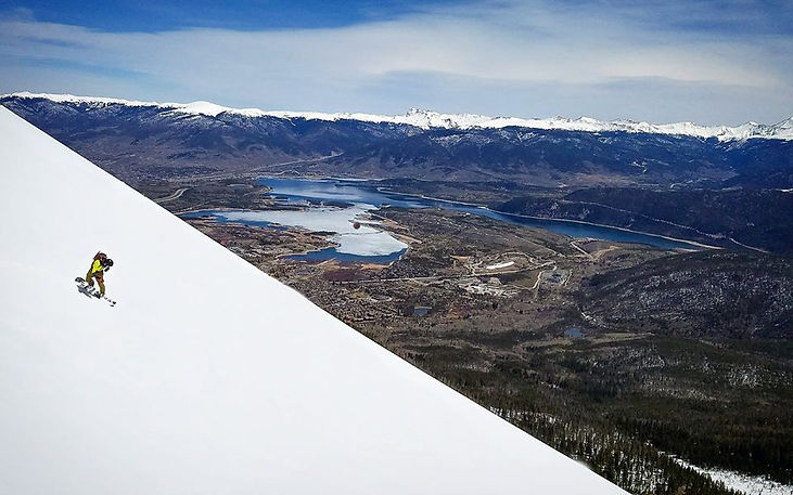 Snowboarding above town and Lake Dillon.