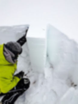 Evaluating the snowpack with a small column test.