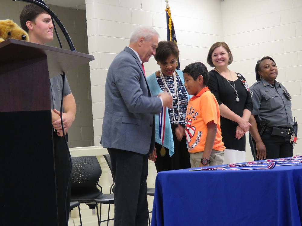 Sheriff Massee awards medal to LVA student