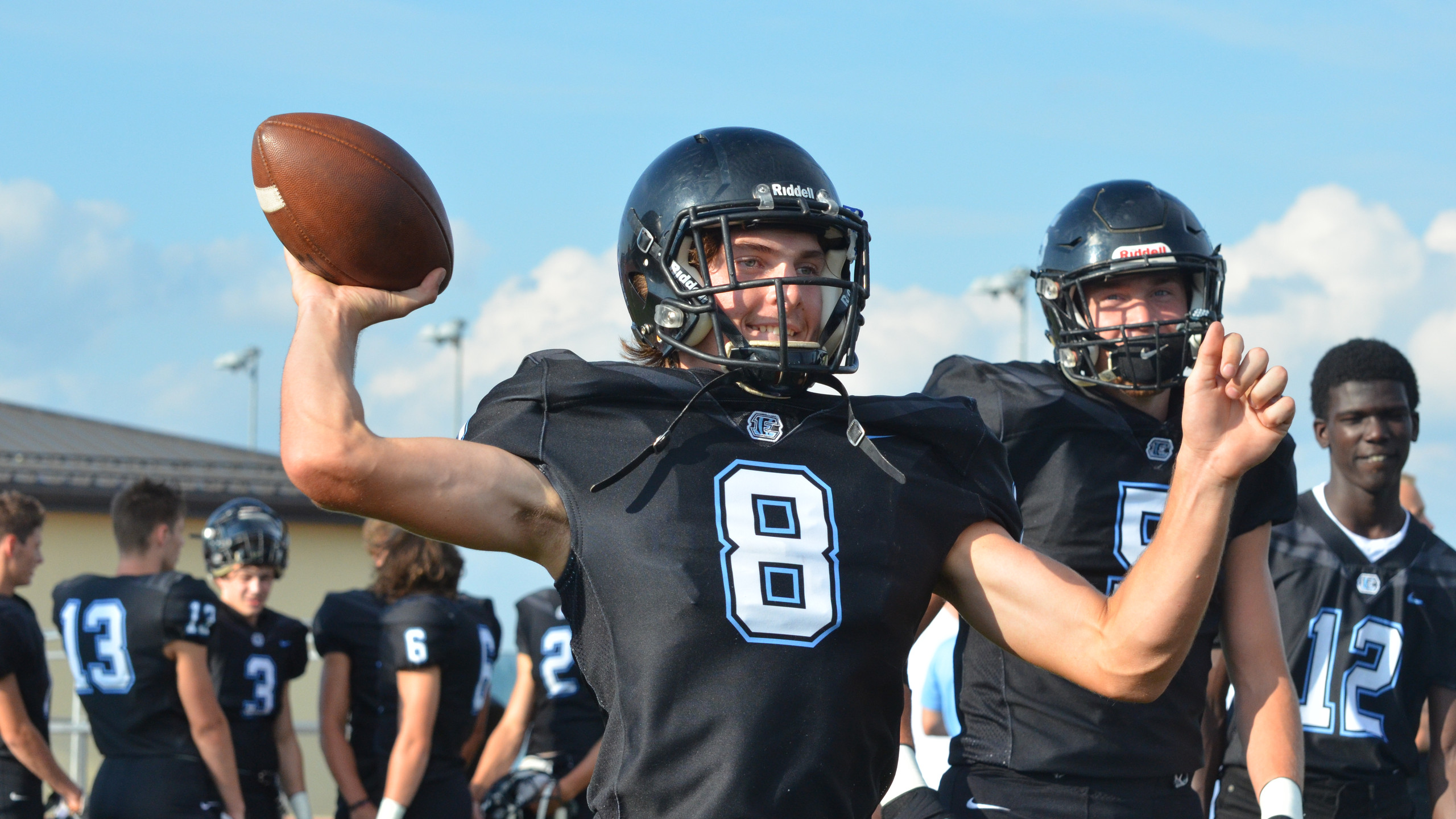 Quarterback junior Tyler Trudo warms up before the scrimmage. Photo by Makylah Perez