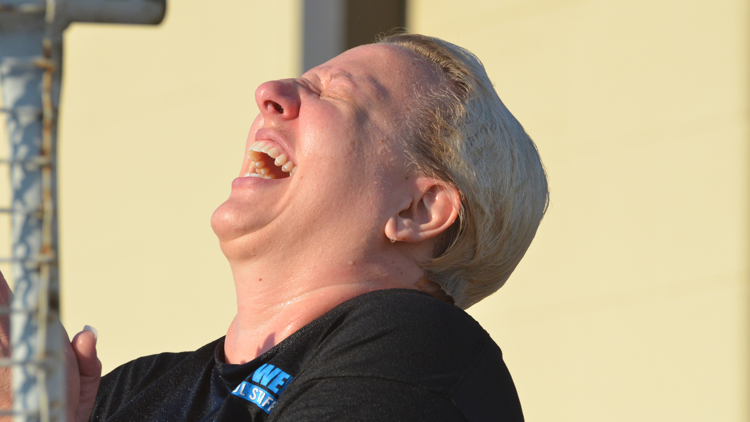 Counselor Kayla Russell laughs while students try to knock her in the dunk tank again during Night at the Ike.  Photo by Makylah Perez