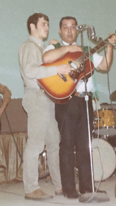 dad and I playing same guitar.PNG