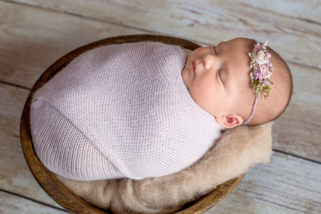 newborn in bowl photography