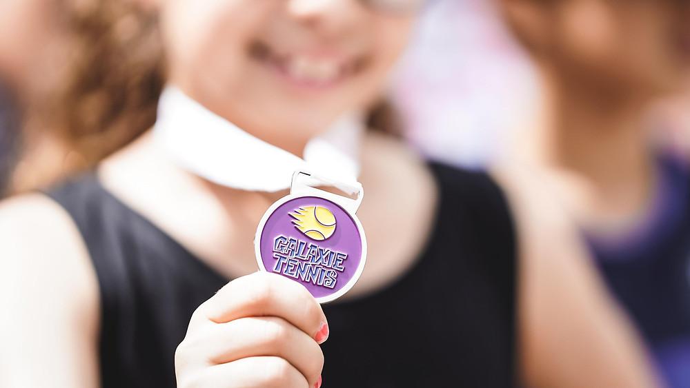 Spin Tennis Academy rewards medal