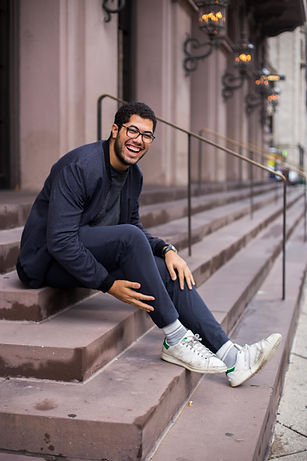 man-sitting-on-stair-while-smiling-16991