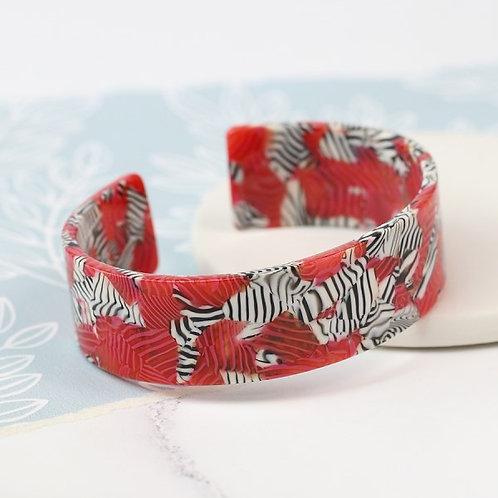 POM - Red acrylic bangle with striking zebra pattern